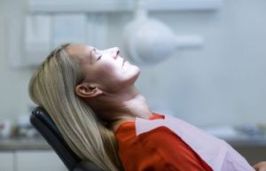Woman in Dental Chair Under Sedation Atlanta GA