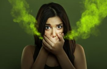 woman suffering from halitosis