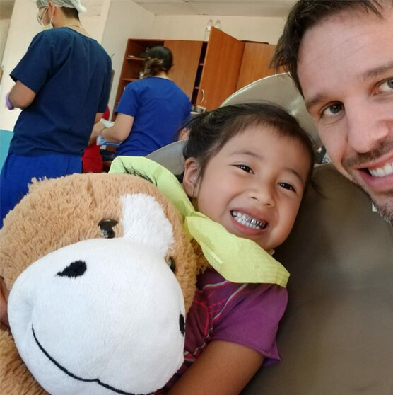 Dr. Scott with a young patient