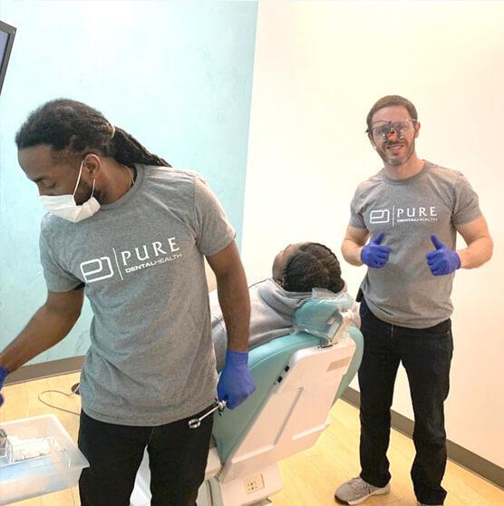 Dr. Scott with a patient