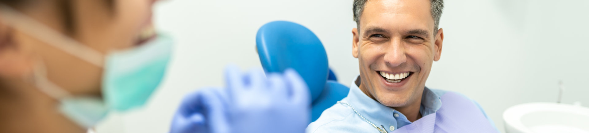 patient sitting in dentist chair